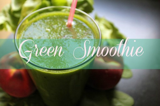 cleansing green smoothie in glass with ingredients
