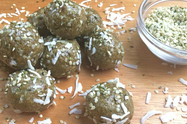 superfood energy balls recipe, coconut energywith coconut flakers and bowl of hemp seeds