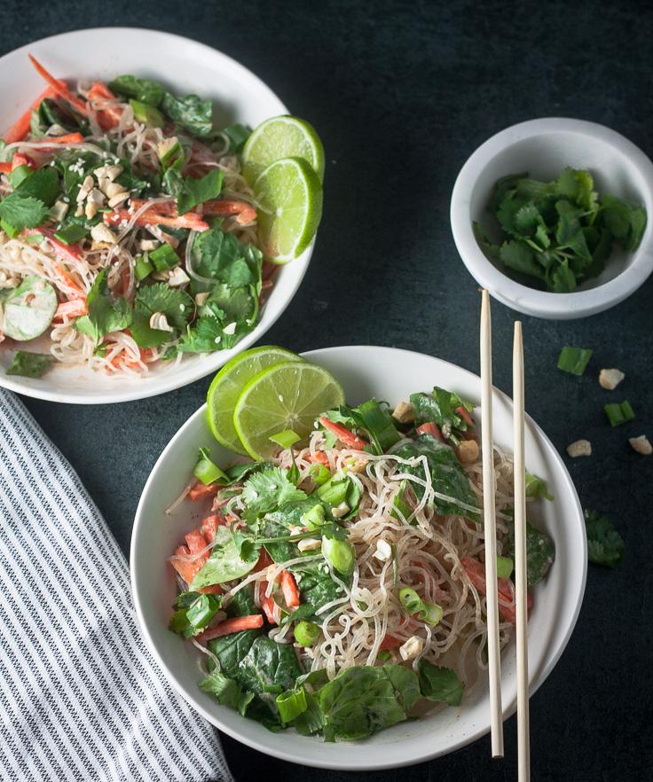 thai kelp noodle salad in white bowl with chopsticks