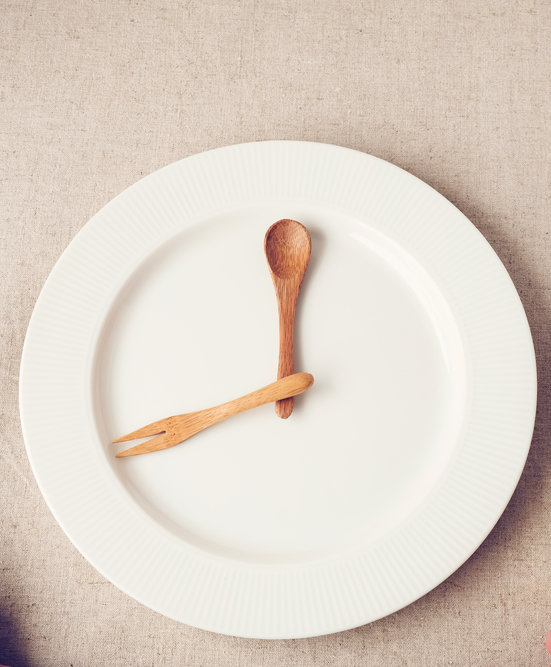 white plate with wood spoons intermittent fasting