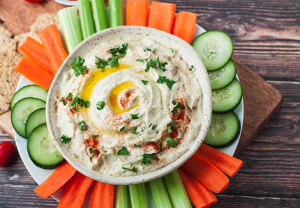 baba ganouch with sliced vegatables on wood background