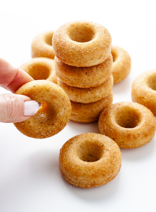 mini donuts with hand on white background